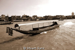 Longtail boat on the Chao Phraya river. by Stuart Ganz 
